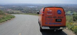 Water Damage Restoration Van Navigating To Job Location