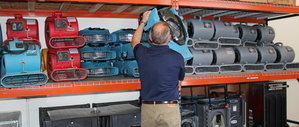 Water Damage Professional Prepping Air Movers For Flooding Job